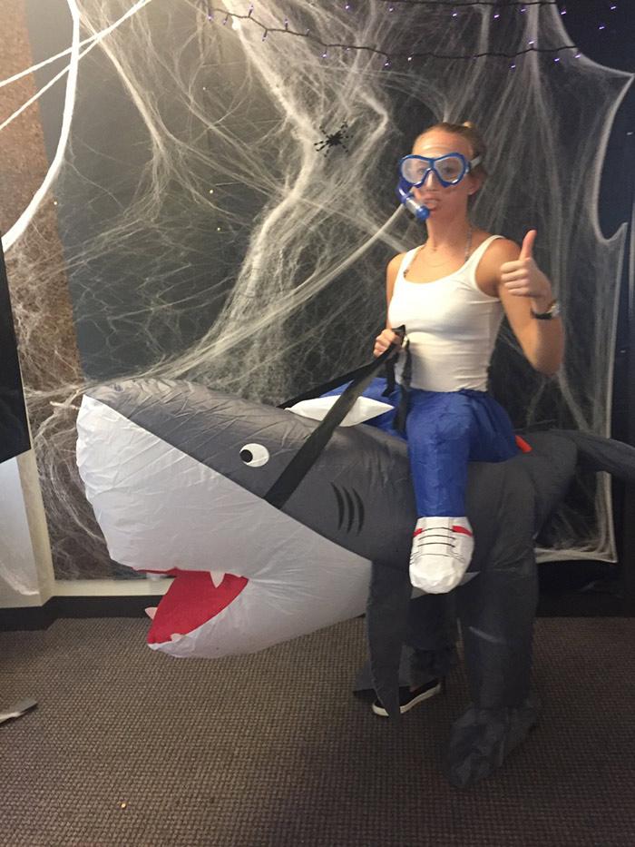 Erin riding a shark