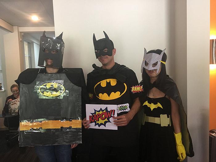 Three people dressed as batman