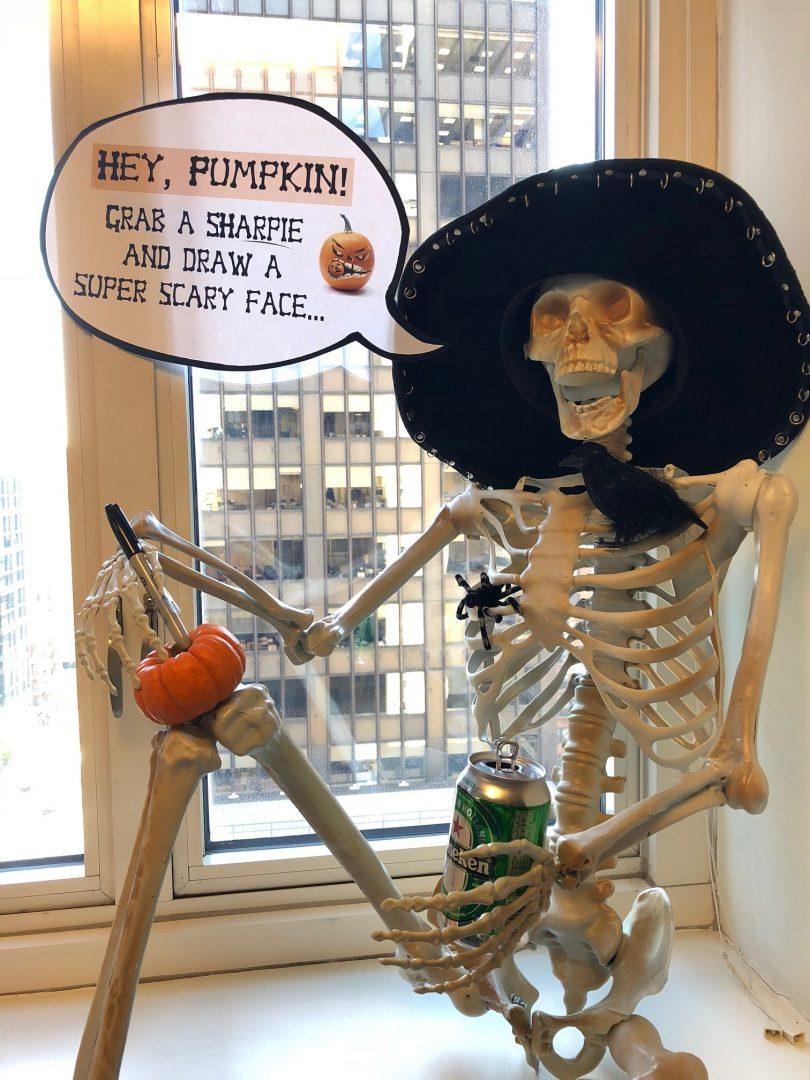 Skeleton in a hat with a beer
