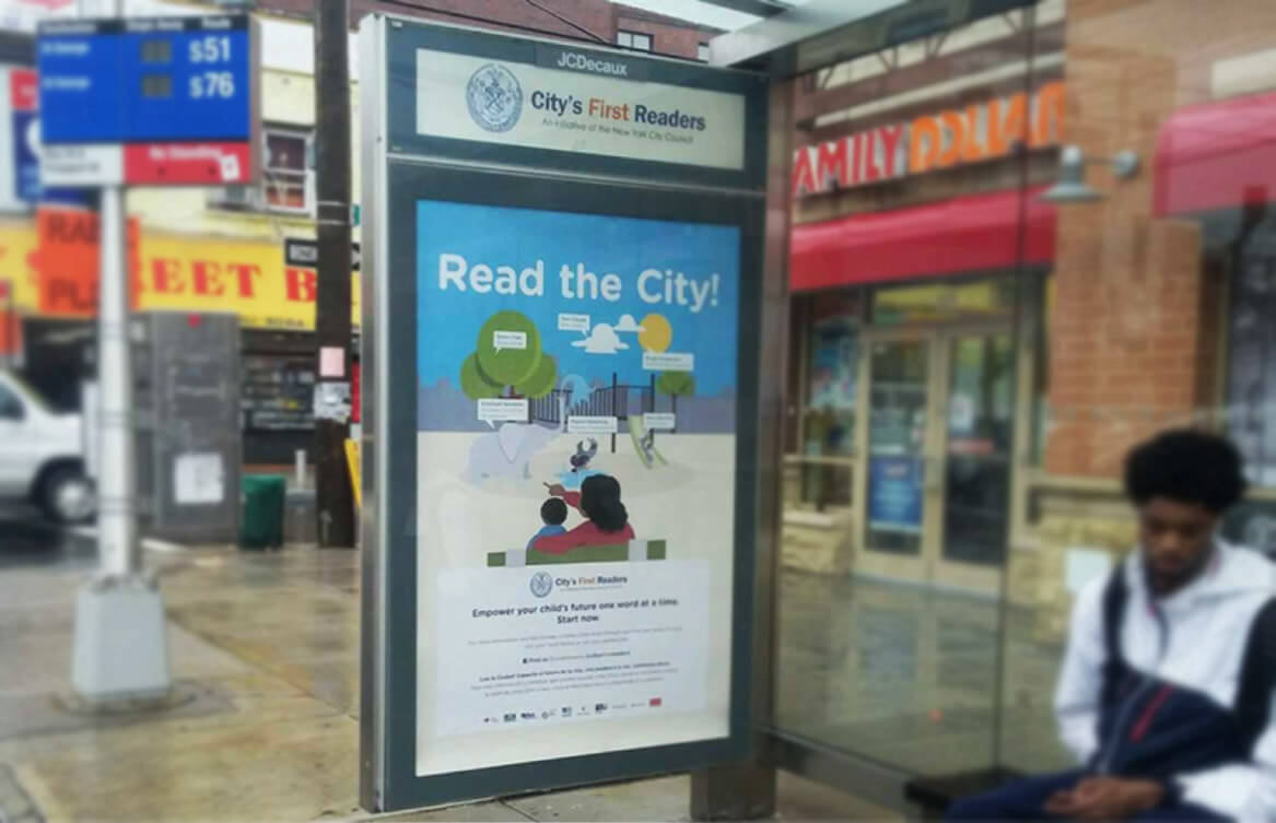 A 'Read the City!' ad in a bus shelter